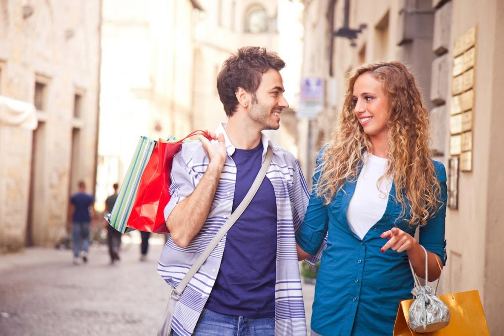 Window shopping is a good outdoor activity to make a first date interesting.